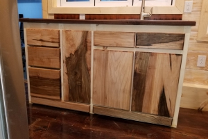 Daisy from Hummingbird Tiny Housing - beautiful hickory cabinets (Custom)